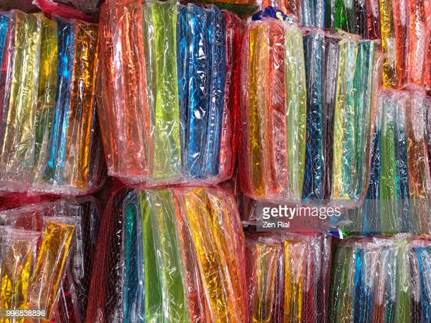 Colorful freezies also called freeze pop snacks on display for sale in a supermarket