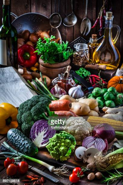 Colorful fresh organic vegetables shot on rustic kitchen