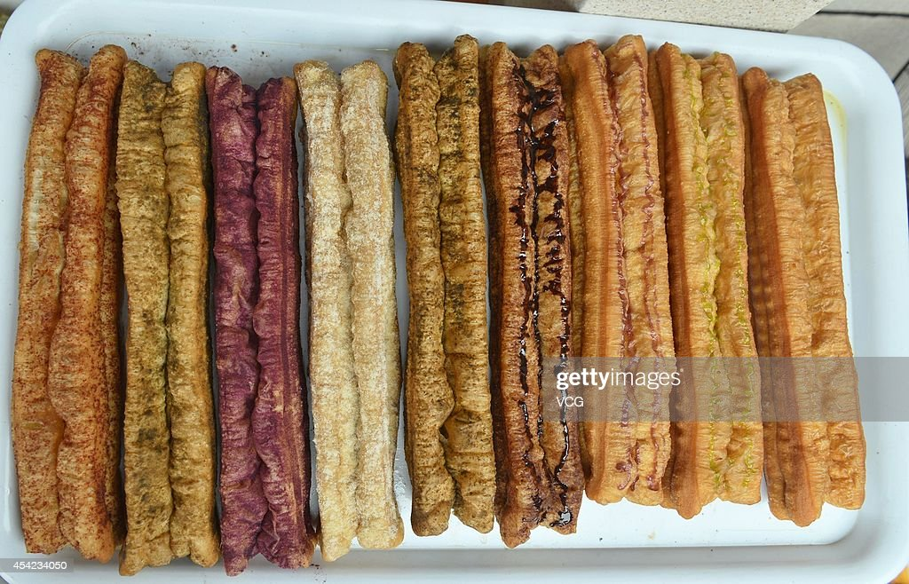 Colorful fried breadsticks made by mixed flour with flavors of vegetables, chocolate, matcha and so on are seen on August 27, 2014 in Hangzhou, Zhejiang province of China. Fried breadstick is one of China's traditional food that usually eaten during breakfast.