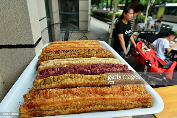 Colorful fried breadsticks made by mixed flour with flavors of vegetables chocolate matcha and so on are seen on August 27 2014 in Hangzhou Zhejiang...