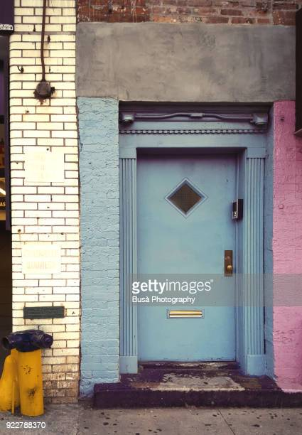 colorful front door and brick wall along dekalb avenue in brooklyn, new york city - humility stock pictures, royalty-free photos & images
