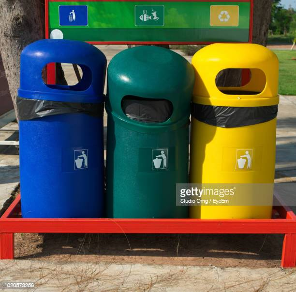 Colorful Garbage Cans On Footpath