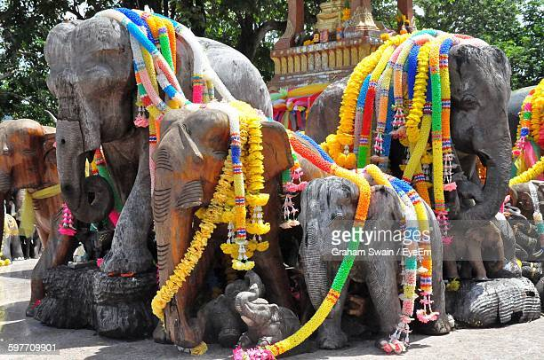 Colorful Garlands On Elephants Statues