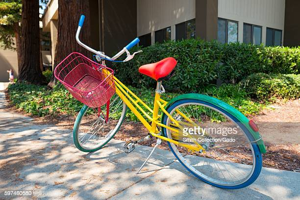 Colorful Google Bike parked in front of a building at the Googleplex headquarters of the search engine company Google in the Silicon Valley town of...