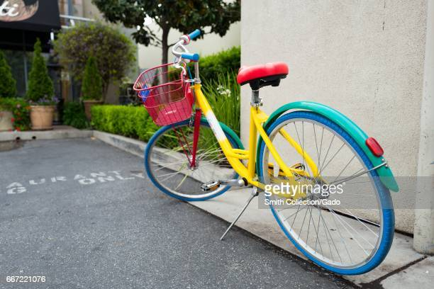Colorful Google Bike parked near a wall in a shopping center near the Googleplex the Silicon Valley headquarters of search engine and technology...