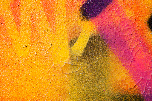 Colorful graffiti over a cracked surface - gettyimageskorea