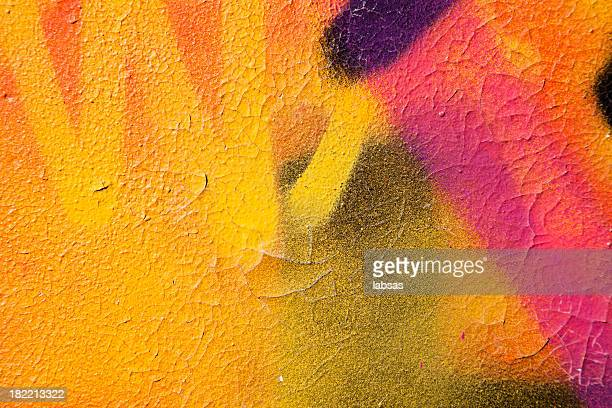 colorful graffiti over a cracked surface - muur stockfoto's en -beelden