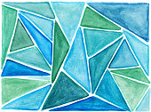 Colorful green and blue triangular shapes hand painted on paper