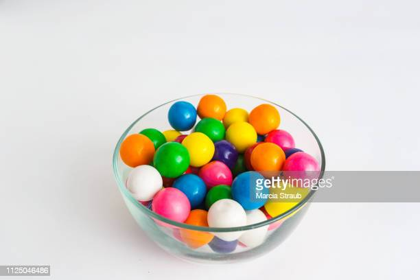 colorful gumballs on white background - sweet food stock pictures, royalty-free photos & images