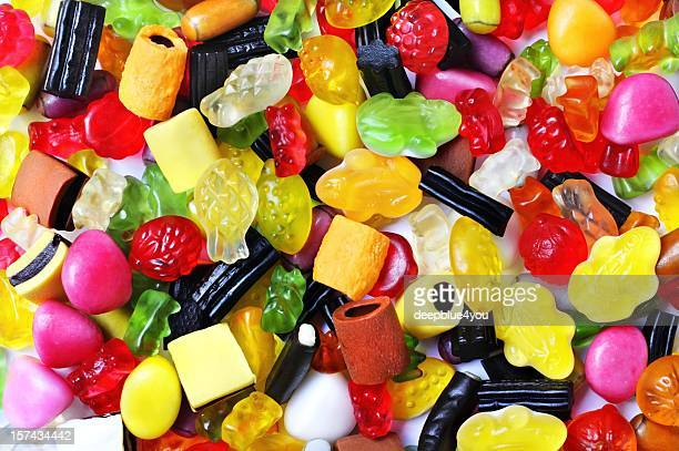 colorful gummibears sweets licorice background - gummi bears stock photos and pictures