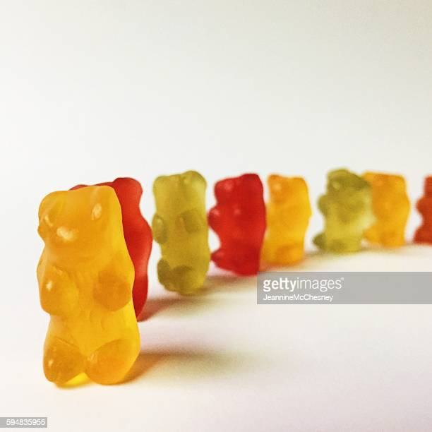 Colorful gummy bears lined up in a circle