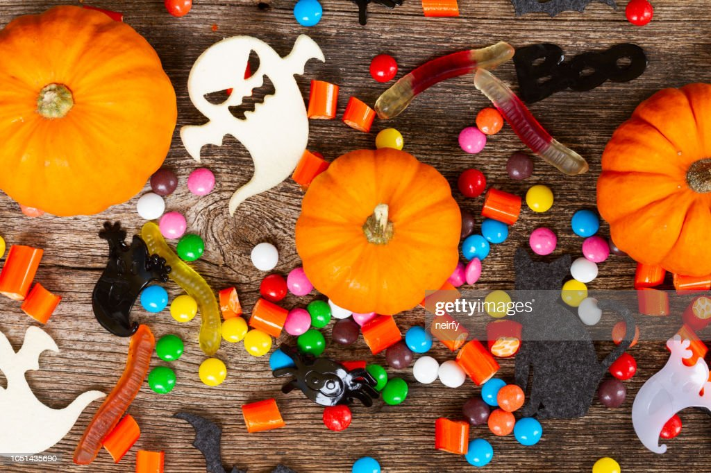 Colorful halloween candies on wood : Stock Photo