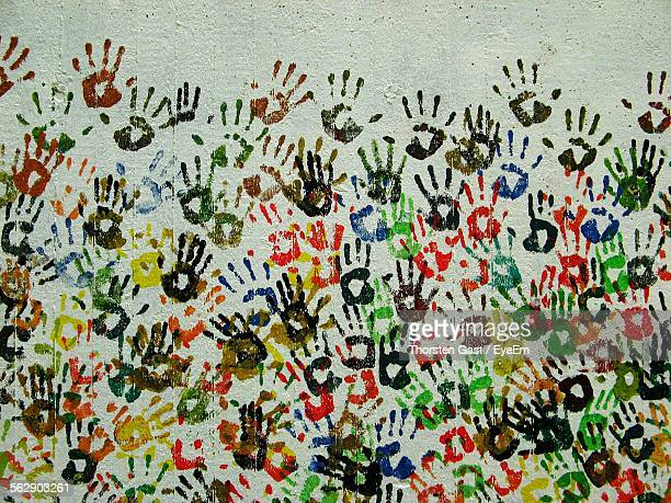 Colorful Hand Prints On Wall