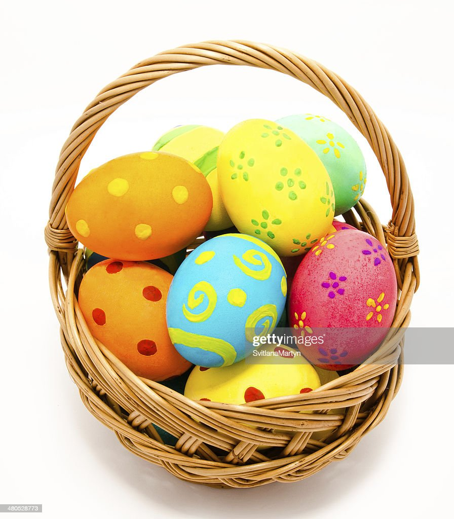 Colorful handmade easter eggs in the basket isolated : Bildbanksbilder
