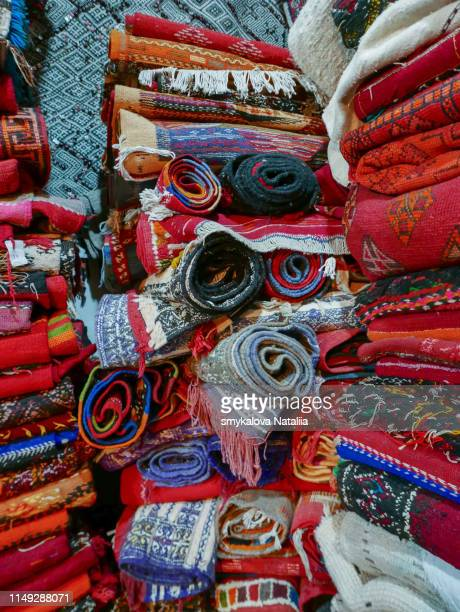 colorful handmade rugs piled up on display at central market. traditional handmade colorful rug - oekraïne stockfoto's en -beelden