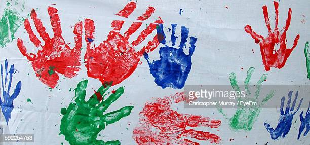Colorful Handprints On Wall