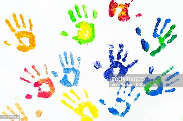 Colorful Handprints On White Background