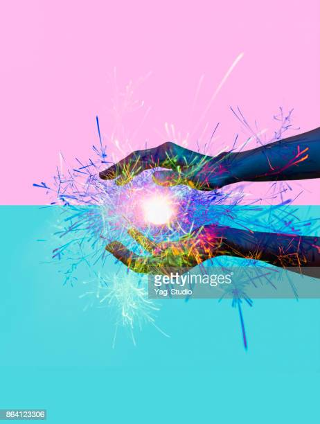 Colorful hands and sparks