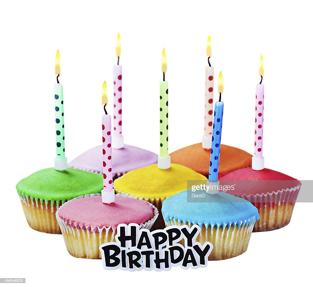 Colorful Happy Birthday Cupcakes With Candles Stock Photo