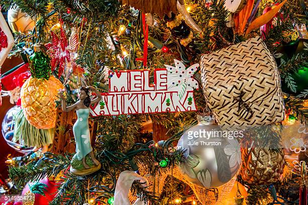 colorful hawaiian merry christmas tree ornaments - hawaii christmas stock pictures, royalty-free photos & images