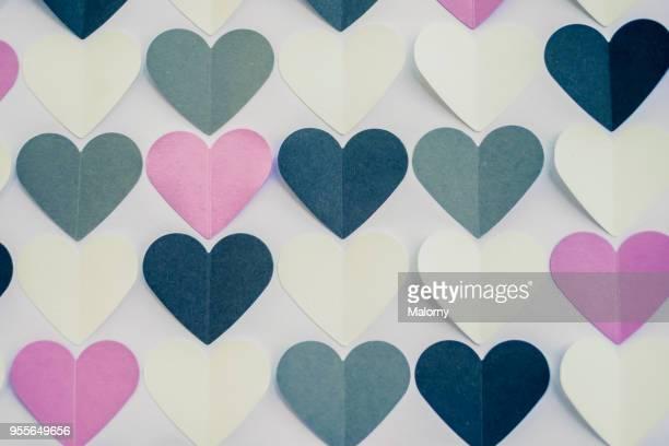 colorful heart shaped papers on white background. - love at first sight stock pictures, royalty-free photos & images