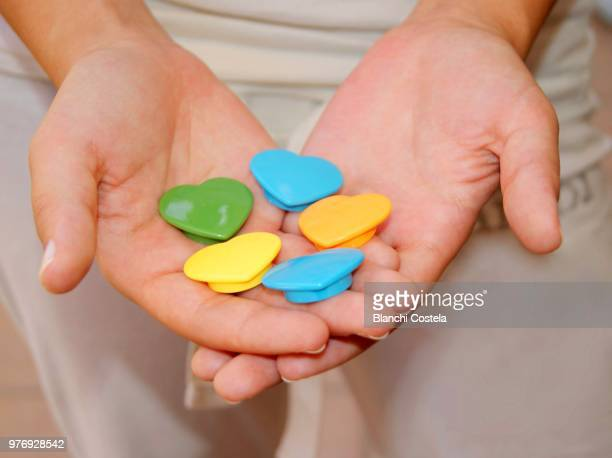Colorful hearts in the hands of a girl