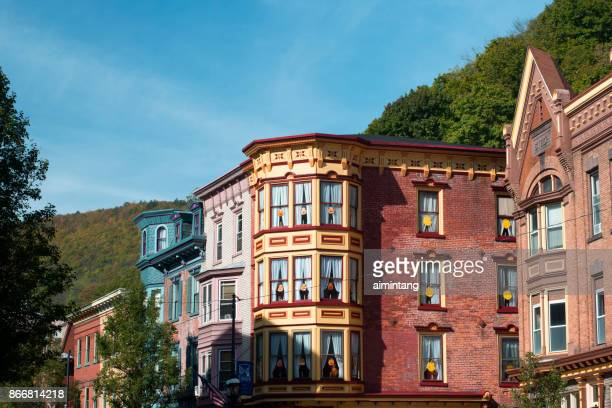 colorful historic buildings on broadway street in downtown jim thorpe - jim thorpe pennsylvania stock photos and pictures