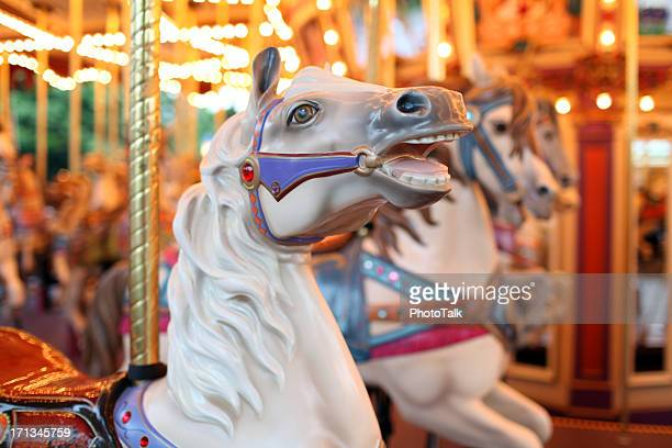 colorful holiday carousel horse - xxxlarge - traveling carnival stock pictures, royalty-free photos & images