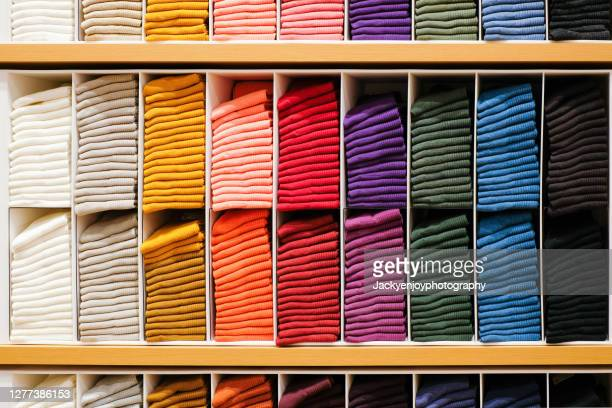 colorful horizontal various socks on wooden shelf in cloth store - garment stock pictures, royalty-free photos & images
