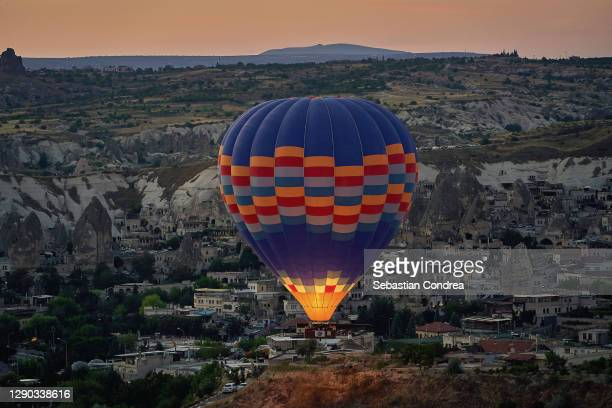 colorful hot air balloon before launch at cappadocia, turkey. volcanic mountains in goreme national park.. - royal tour stock pictures, royalty-free photos & images