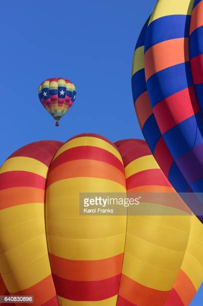 Colorful hot air balloon flying by
