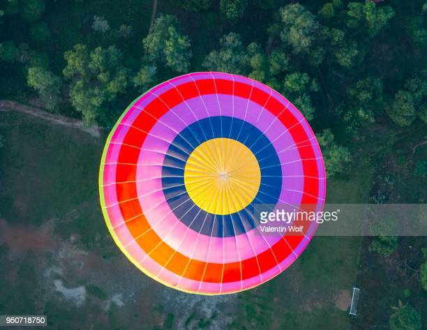 Colorful hot air balloon in the air from above, bird's eye view, Vang Vieng, Vientiane Province, Laos