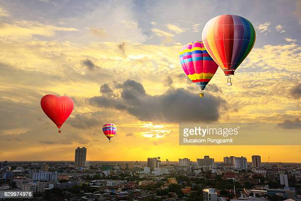 Colorful hot air balloon is flying at sunseet