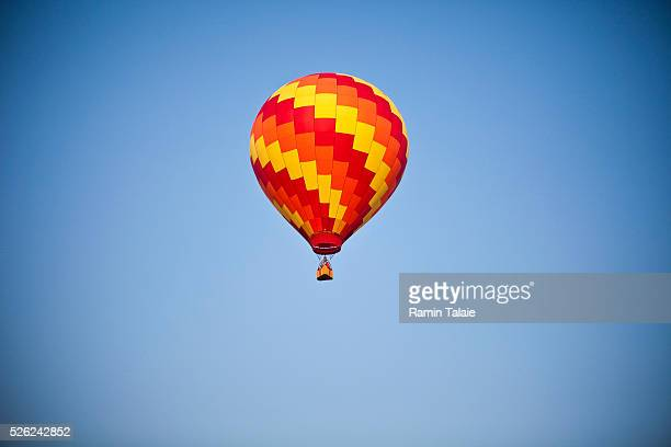 A colorful hot air balloon launches during the New Jersey Festival of Ballooning at Solberg Airport in Readington NJ on Saturday July 24 2010