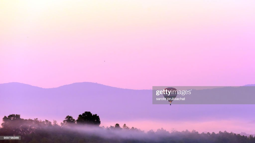 Colorful hot air balloon on sunrise sky over mountain . : Stock Photo