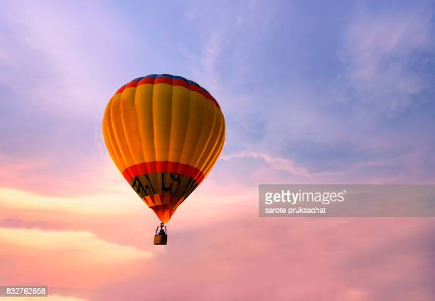 Colorful hot air balloon on sunset sky.