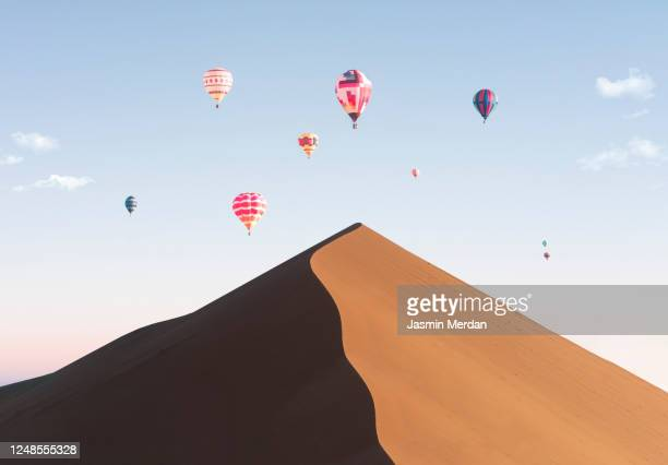 colorful hot air balloon over desert at sunset - dubai stock pictures, royalty-free photos & images