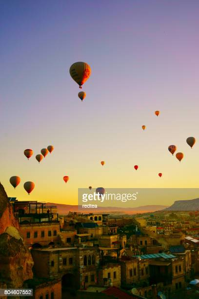 colorful hot air balloons flying over the valley at cappadocia - rock hoodoo stock pictures, royalty-free photos & images