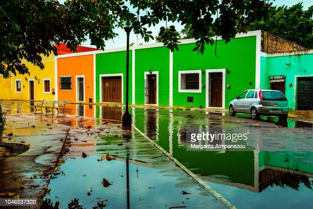 Colorful houses and their reflection in the streets of Valladolid