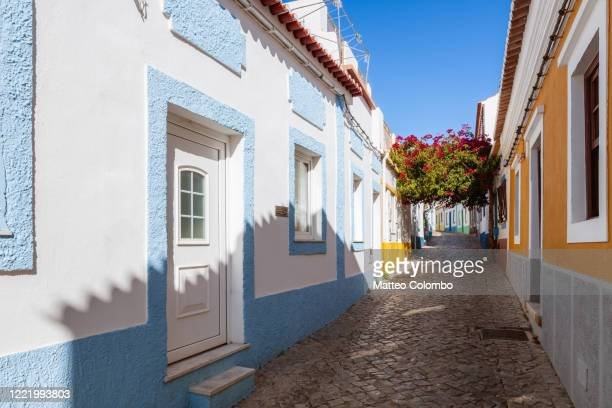 colorful houses in ferragudo, faro, algarve, portugal - traditionally portuguese stock pictures, royalty-free photos & images