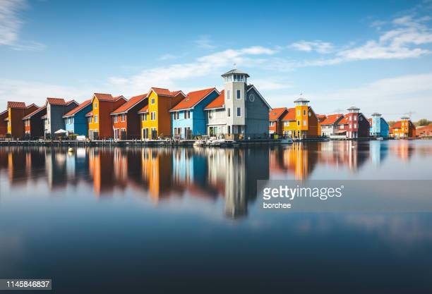colorful houses in groningen - groningen province stock photos and pictures