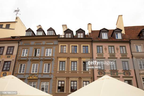 Colorful houses in Old Town Market Place (Rynek Starego Miasta) over the umbrellas