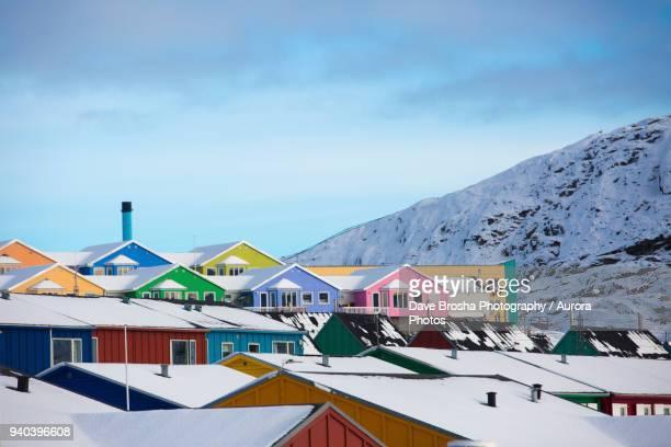 colorful houses in town of ilulissat, greenland, denmark - ilulissat stock-fotos und bilder