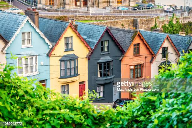 colorful houses near cathedral in cobh, ireland - cork city stock pictures, royalty-free photos & images