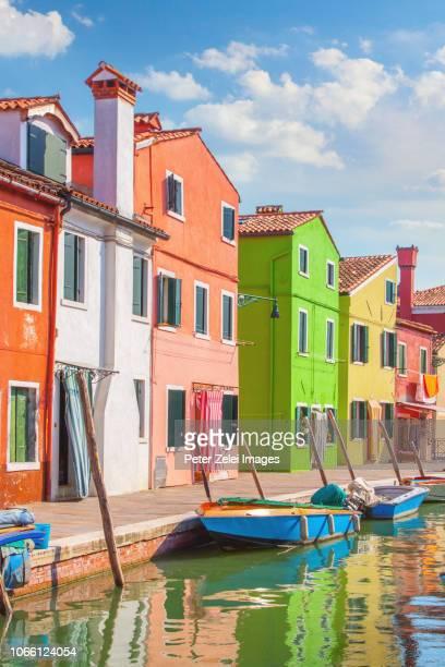 colorful houses of burano, italy - burano foto e immagini stock