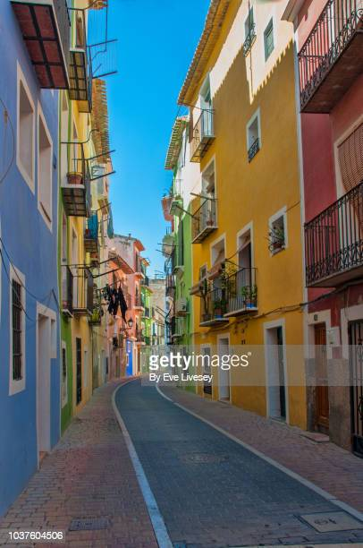 colorful houses on a narrow street - valencia spain stock pictures, royalty-free photos & images