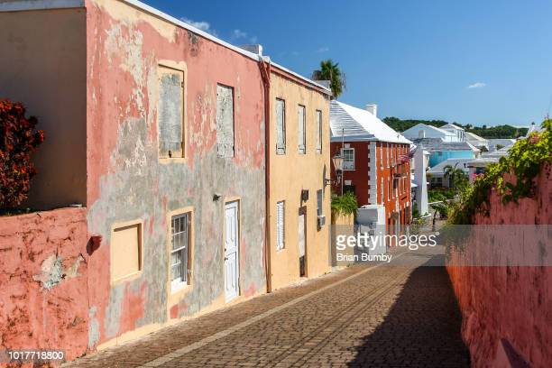 colorful houses on old street in st. george's, bermuda - bermuda stock pictures, royalty-free photos & images