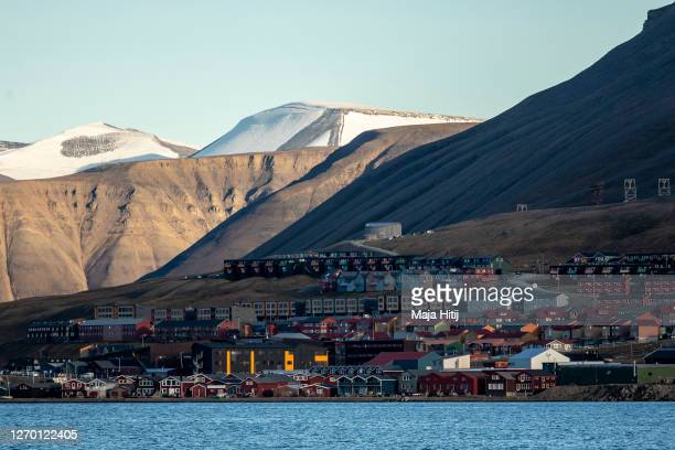 Colorful houses stand in a row on Svalbard archipelago on August 25 2020 in Longyearbyen Norway Longearbyen located far north of the Arctic Circle is...