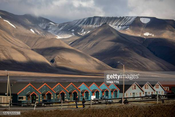 Colorful houses stand in a row on Svalbard archipelago on August 27 2020 in Longyearbyen Norway Longearbyen located far north of the Arctic Circle is...