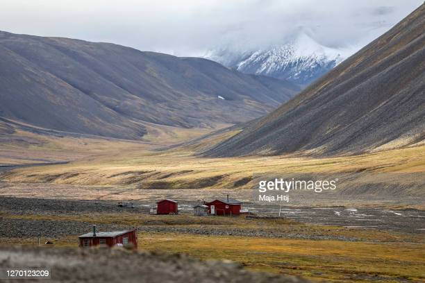 Colorful houses stand on Svalbard archipelago on August 27 2020 near Longyearbyen Norway Longearbyen located far north of the Arctic Circle is the...